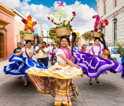 The MXLAN festival will feature calenda-style street parades featuring authentic costumes, giant dancing dolls and music. (Courtesy)