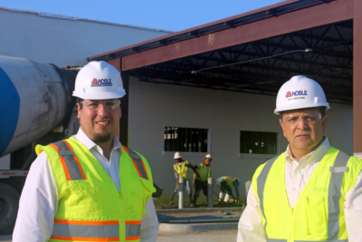 Texas Noble Builders partners Rene Capistran and Alfredo Garcia at the site where the company is constructing an Army/Navy Credit Union building in Brownsville. (VBR)