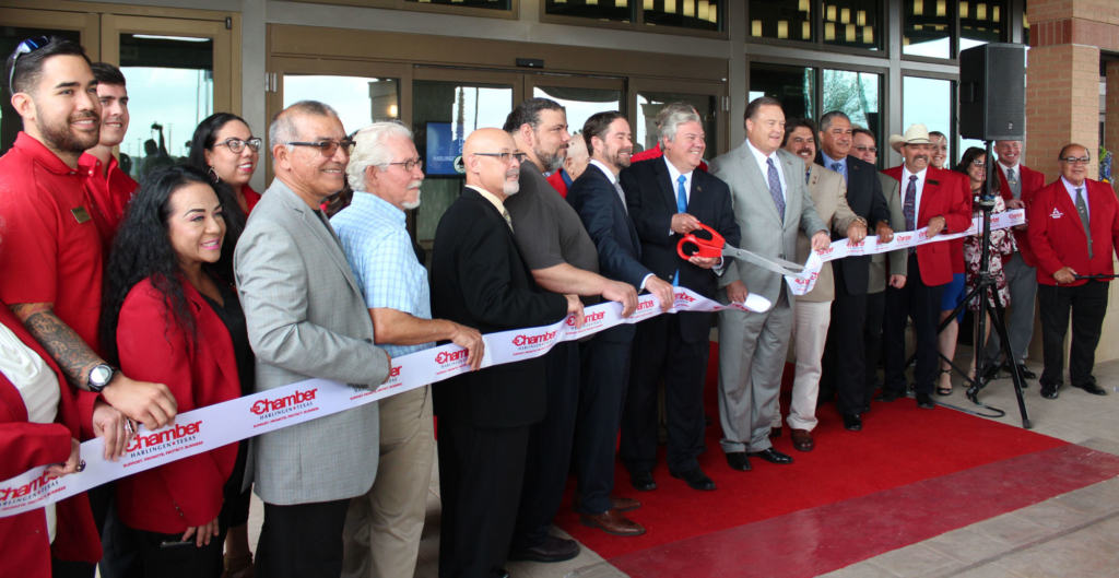Harlingen Mayor Chris Boswell cut the ribbon to officially open the Harlingen Convention Center. (VBR)