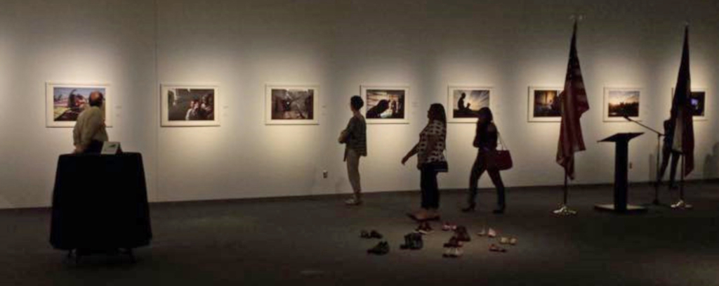 Museum patrons view an exhibit of historical photographs depicting the history of San Benito. (Courtesy)