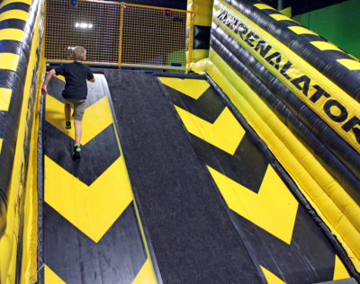 The Ninja Warrior course includes a challenging climb up a treadmill. (VBR)