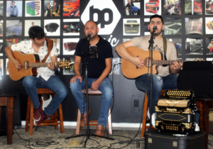 A conjunto trio plays in one of the new music venue in the downtown area. (VBR)