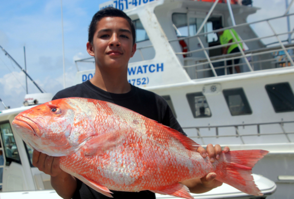 Walker Thanen holds a whopper red snapper he caught during a four hour with Murphy Charter Services.