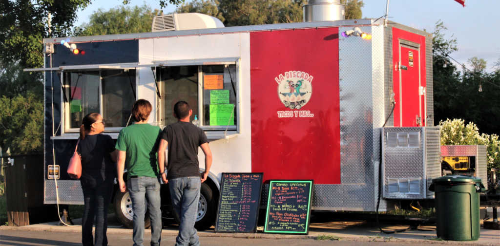 Decisions, decisions, decisions! Customers debate the menu selections at the La Discada taco truck.