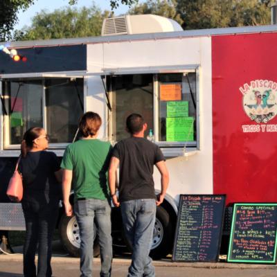 Decisions, decisions, decisions! Customers debate the menu selections at the La Discada taco truck.