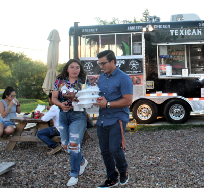 BBQ lovers enjoying Texican BBQ at the Broken Sprocket Food Truck Park.