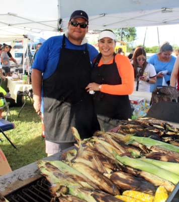 Jesse and Joanna Ruedas of Brownsville sell roasted corn faster than hot cakes at the Rancho Viejo farmers market.