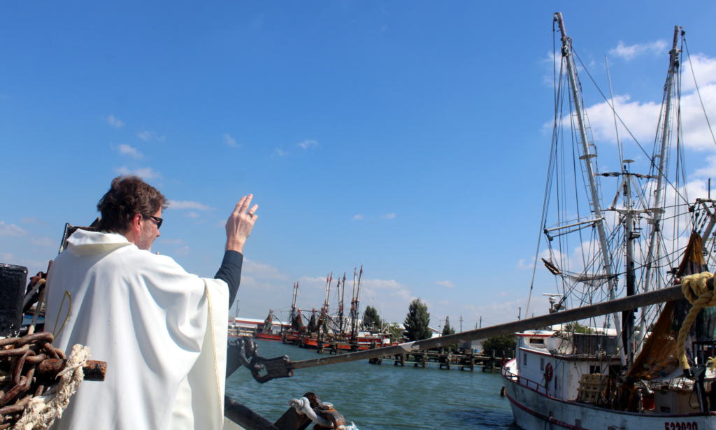 The Rev. Mark Watters blessing the trawler at the Brownsville Shrimp Basin