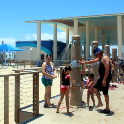 Beachgoers using the new showers at the Sandpiper Pavilion at Isla Blanca Park.