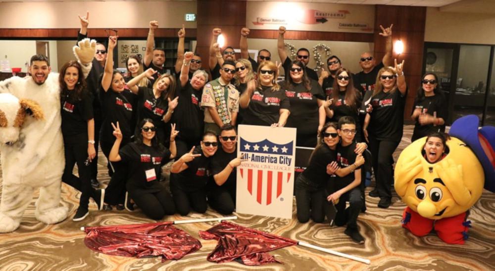 Mission delegation celebrates after gaining All-America City honor in Denver.