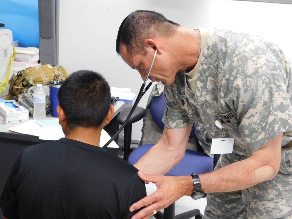 Texas State Guard Lt. Col. Richard Male performs a patient screening in Mission during Operation Lone Star.