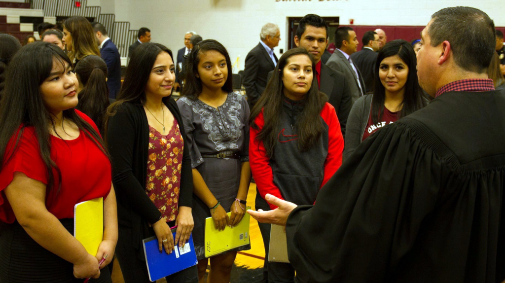 Judge Luis Singleterry visits with students after a PSJA Court in Schools session. (photo PSJA ISD)