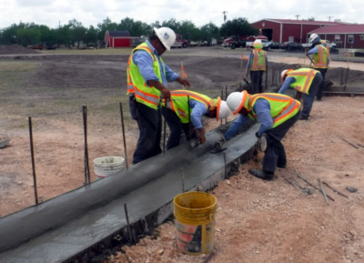 Construction crews work to add curbs to the new park construction. (Courtesy)