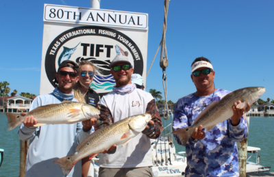 Fishermen showing off some of their catches during the TIFT tournament.