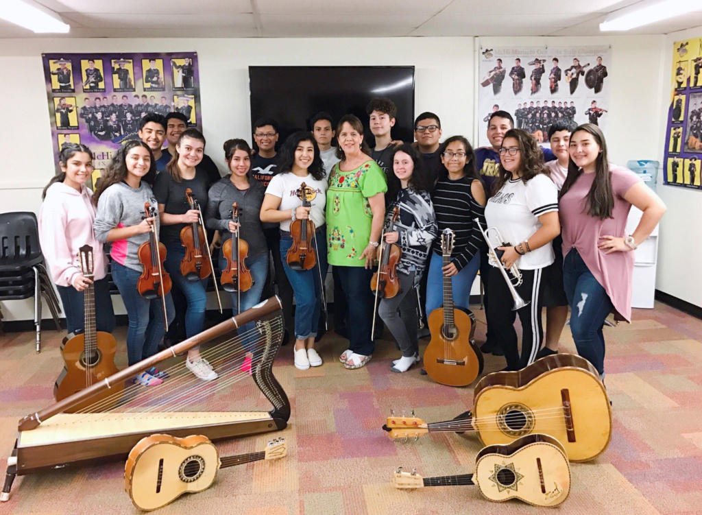 """The McHi Mariachi Oro Booster Club is a repeat customer for the Macaroni Grill """"2 for $20"""" fundraiser."""