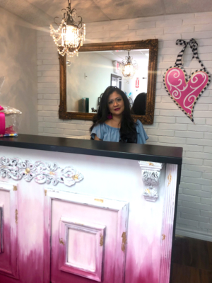 Very Artsy owner Veronica Cerda-Ayala stands at her checkout counter which was once an old restaurant cashier stand. Ayala transformed the counter by adding the molding details on the front and painting in a trendy ombre pattern.