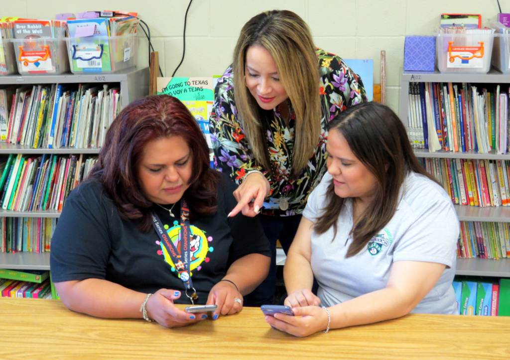 Letty Macias, Belinda Trevino and Karen Aguirre, teachers at Perez Elementary in McAllen ISD, look over their Amazon classroom wish lists.