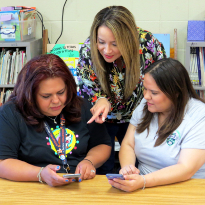 Letty Macias, Belinda Trevino, and Karen Aguirre, teachers at Perez Elementary in McAllen ISD, look over their Amazon classroom wish lists.