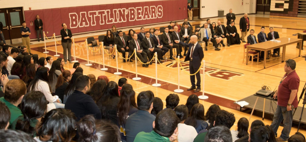 Attorney Jaime Pena conducts a mock law school class in a PSJA school gym.