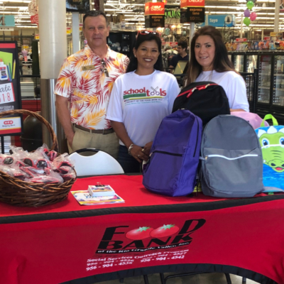 "Setting up ""Fill the Bus"" are Mike Bigelow of Schlitterbahn, School Tools manager Erica Lechuga and RGV Food Bank Agency Referral Specialist Lynda Galvan."