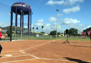 Olympic pitcher Monica Abbot Powers throws the pitch to McAllen Mayor Jim Darling.