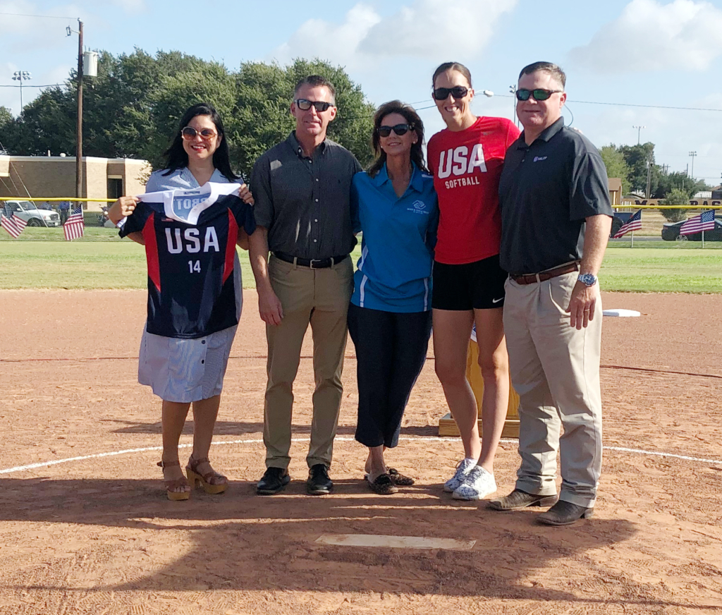 The McAllen Boys and Girls Club is presented with a jersey from Team USA and Monica Abbot Power. Seen here are Dalinda Alcantar, Mark Voss, Kaylynn Norman, Monica Abbott Power and Trey Murray,