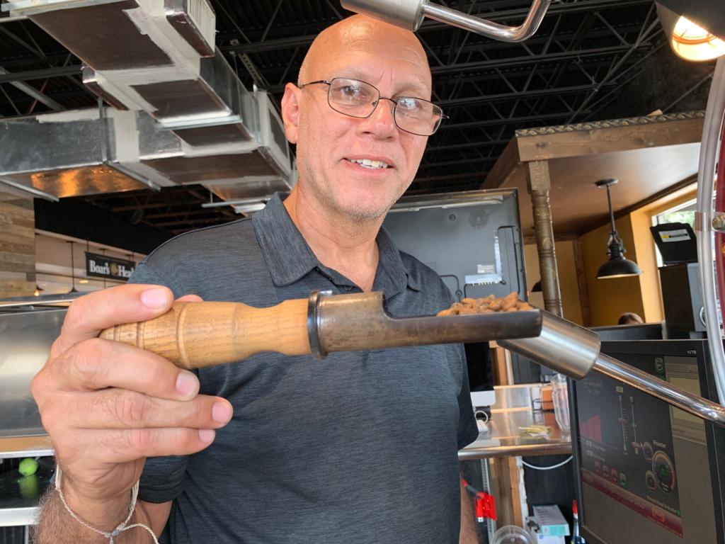 Owner Luis Beltran oversees the coffee roasting himself inside Moonbeans Coffee.