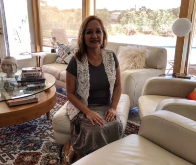 Nydia Tapia Gonzales sits in her John York-designed home in Harlingen.