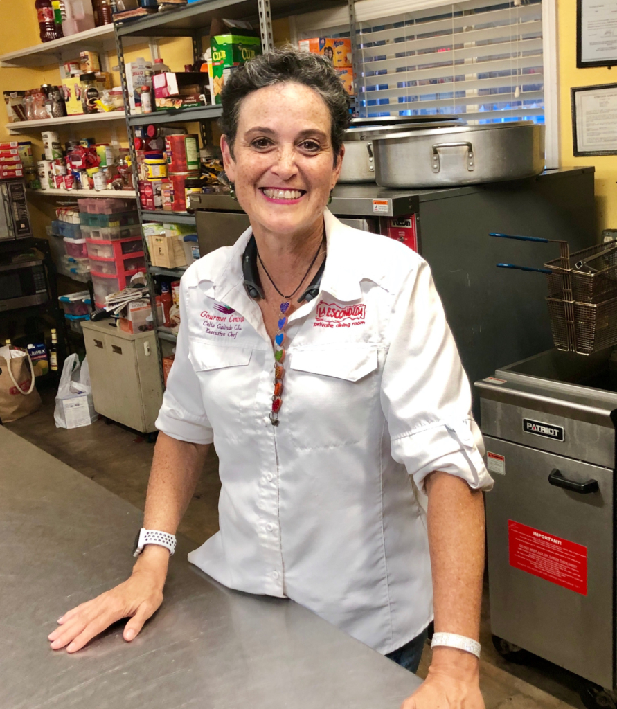 Celia Galindo serves up catering orders and cooked meals for those passing through BRO customs in her Gourmet Central by Cel kitchen.
