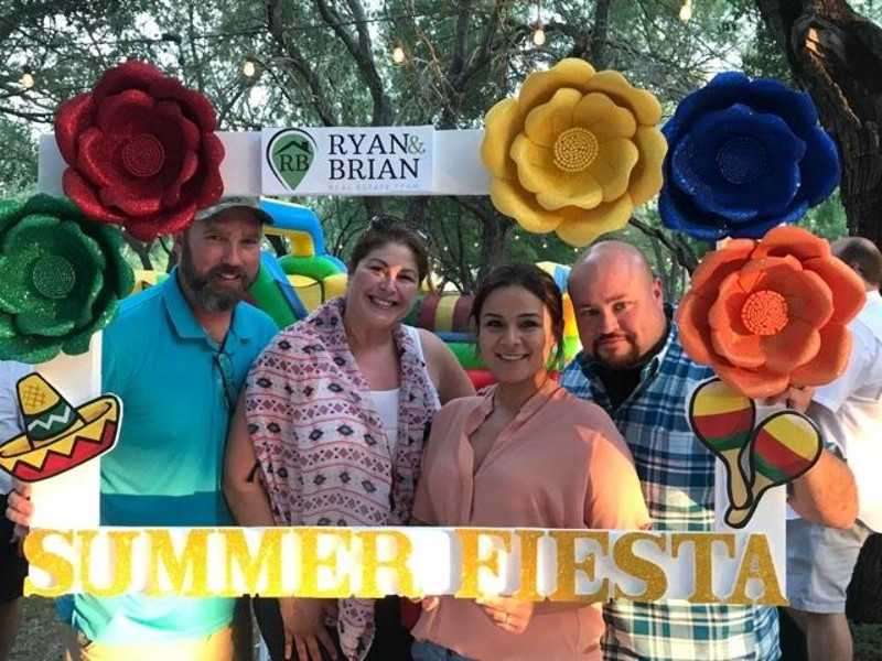 "The Ryan & Brian Teams ""Raving Fans"" enjoyed a photo op at the Summer Fiesta customer appreciation event."