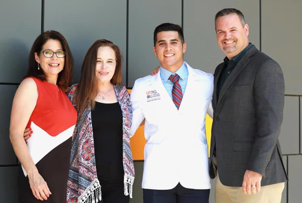UTRGV School of Medicine Class of 2023 student Roman Silva at the school's White Coat Ceremony July 27 with his aunt Jennifer Nixon, mom Amy Silva and uncle Beau Nixon. (photo Diane Nixon)