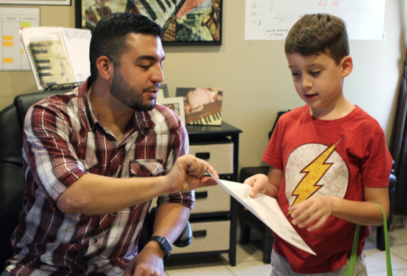 Founder of Musical Living Academy Edelir Garza offers one of his students some pointers after a private lesson.