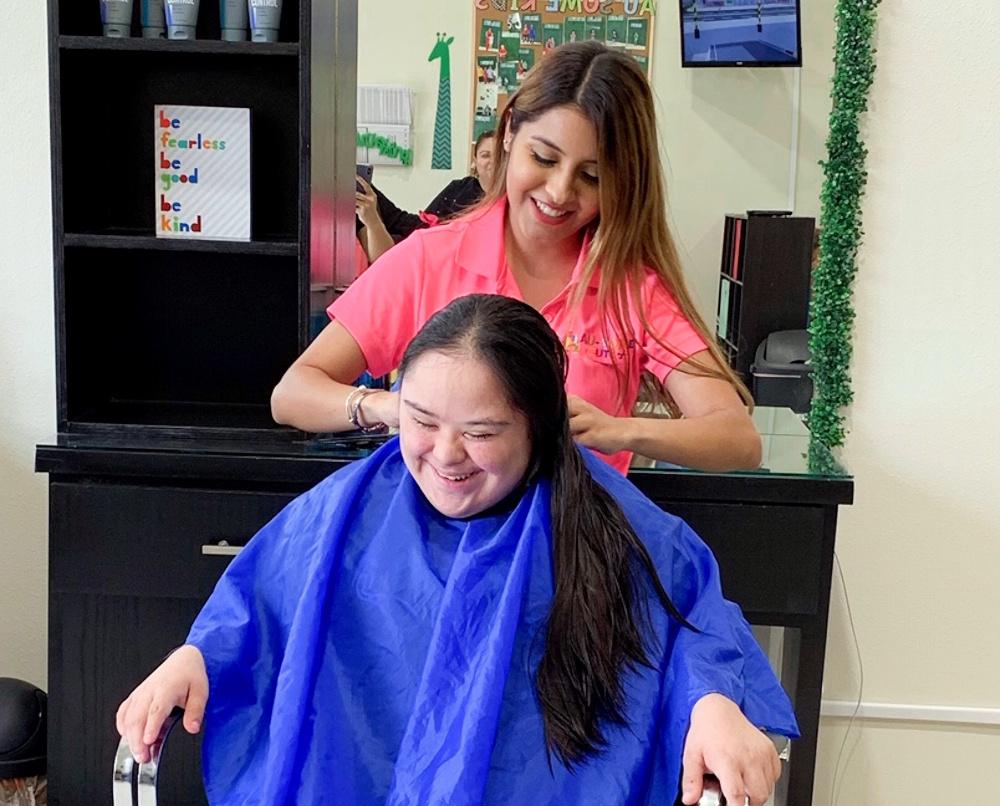 Alexia Saenz cuts a client's hair at Au-Some Cuts.