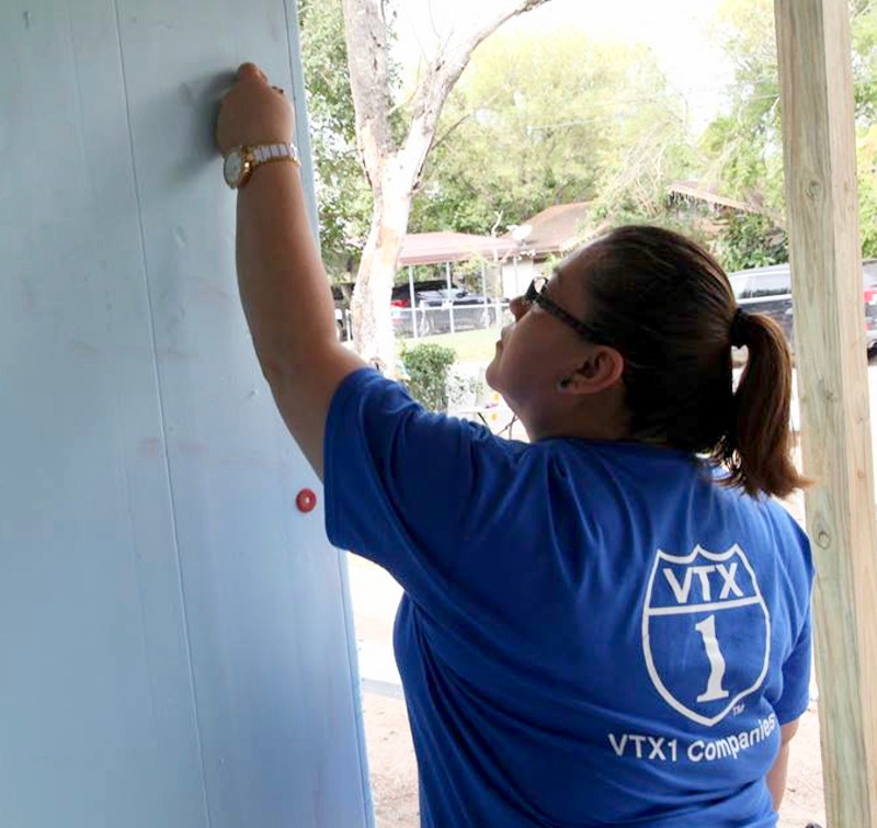 A VTX1 employee does her part at a Habitat for Humanity project. (photo VTX1)