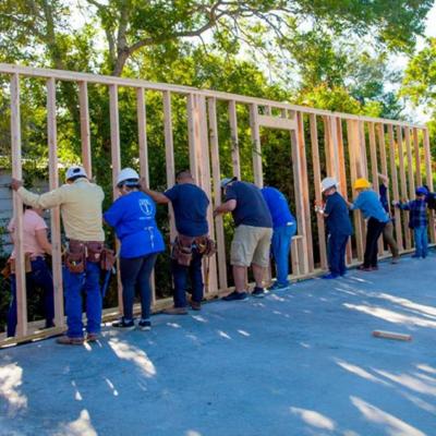 VTX1 employees raise the frame for a Habitat home. (photo VTX1)
