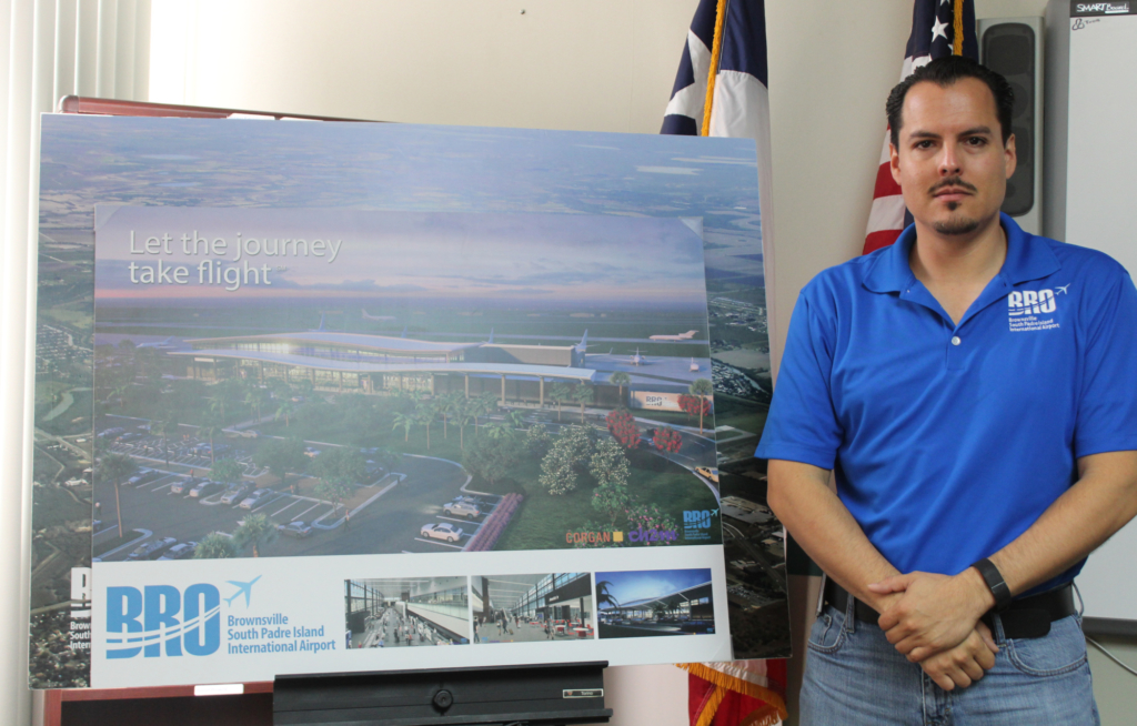 Francisco Partida, the airport special projects manager, stands next to an artist rendition of the future terminal.