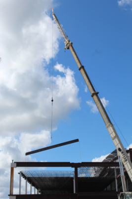 A crane lifts a beam as construction of the new Brownsville South Padre Island International Airport terminal continues.