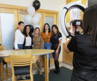 Make-up artist Yvette Hinojosa, Edna Posada, Shop 112 marketing manager and assistant buyer Sarah Davila, Alexandria Posada and make-up artist Sarah Hernandez pose for pictures with Ale Pena of Spa La Posada at the Spa's Matte About Hue event Oct. 15 in McAllen.
