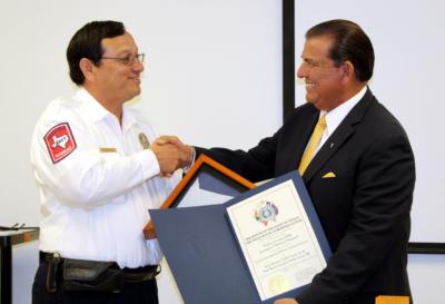 Frank Torres receives the award from Texas Sen. Eddie Lucio Jr.