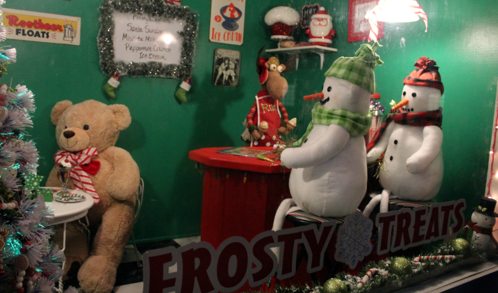 A couple of buddies get into the holiday spirit at the Holiday Village.