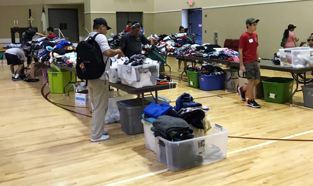 Tables of clothing, shoes, blankets and other supply donations at the semi-annual Emily's Meals picnic. (Courtesy)