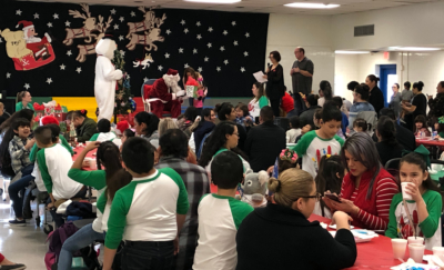RSD students and their families attend the annual gift giving event where Santa and Frosty hand out gifts to children at Escandon Elementary. (Courtesy)