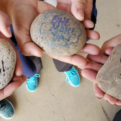 Before the Out of the Darkness Community Walk begins, walkers write messages on rocks to those they have lost to suicide. They carry the rocks with them. At the end of the walk, the rocks are placed at the base of a newly planted tree, symbolizing hope.