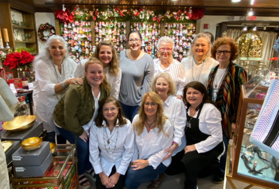 A group of Barn White employees with owners Page Moore and Leslie Ewers and jeweler Andrea Barnett.