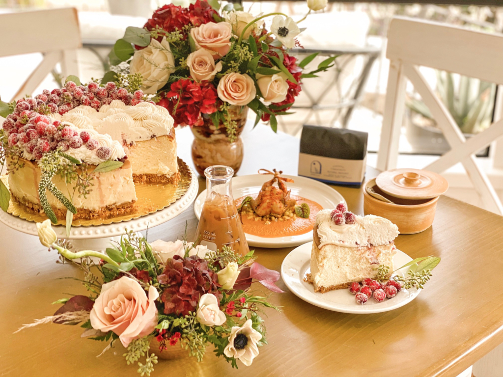The perfect spread for the holidays from local businesses: Cranberry cheesecake from Your Sweets By Kacy, flower arrangement by Southern Roots Flower Market, vanilla saffron latte from Semilla Coffee Lab nd stuffed quail from Salomé on Main.