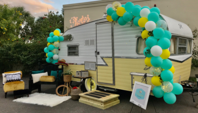 The Happy Camper ready for an event with the outdoor lounge area set up and photos sign lit. (Courtesy)