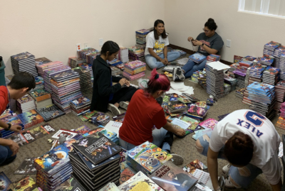 Edinburg High School students volunteer to sort, organize and haul books for a book festival held by the South Texas Literacy Coalition.