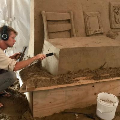 Artist Emerson Wierenga Schreiner creates Santa's workshop from a large block of sand. (Courtesy)