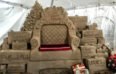 Santa's throne at the Holiday Sandcastle Village is the creation of Lucinda Wierenga and Joaquin Cortez. The businesses featured around the throne helped to support the event. (Courtesy)