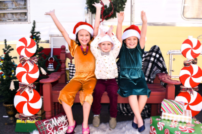 A happy family takes advantage of the festive backdrop at The Happy Camper holiday photo sessions. (Courtesy)